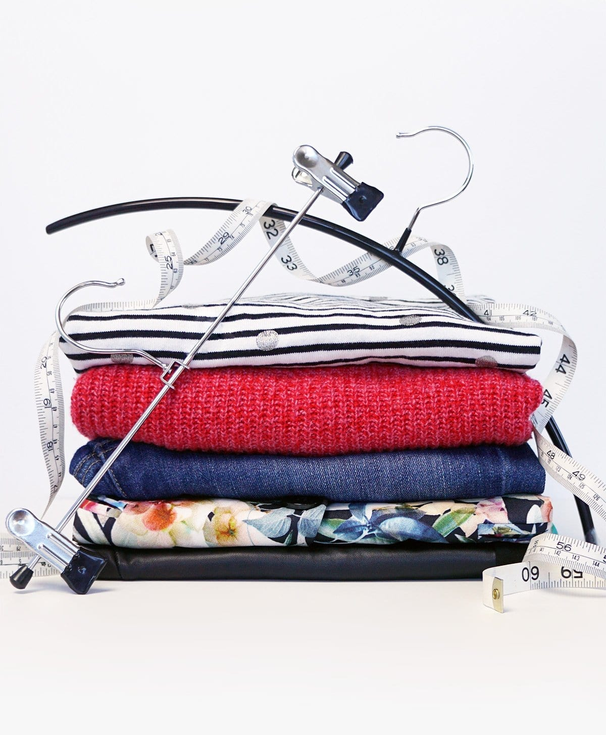folded clothing with a hanger and tapemeasure