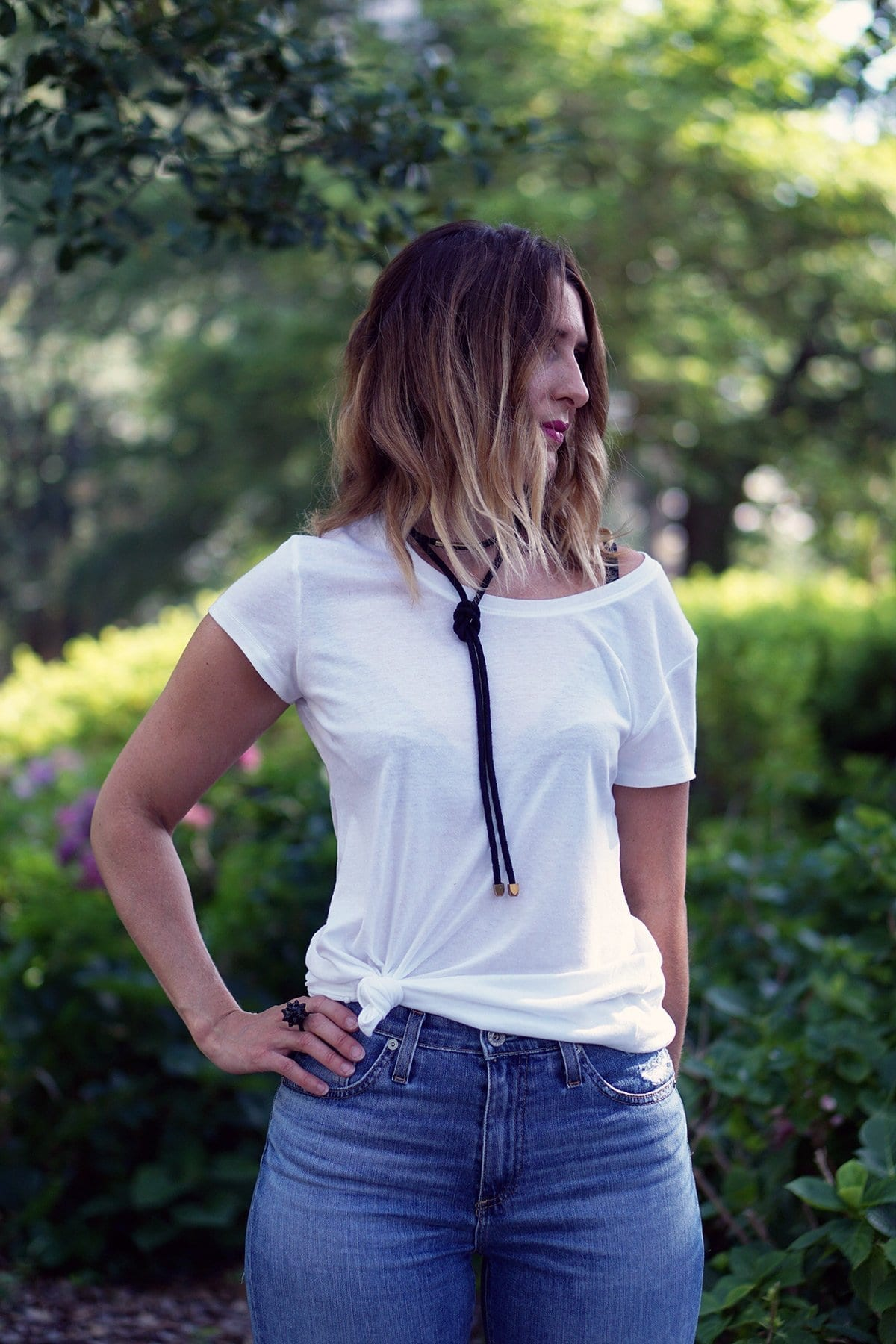 Three simple ways to breathe new life into a plain t-shirt | A white tee is a wardrobe staple, tie it in a knot to add shape, tuck it into your favorite party skirt for everyday, and layer it under a dress