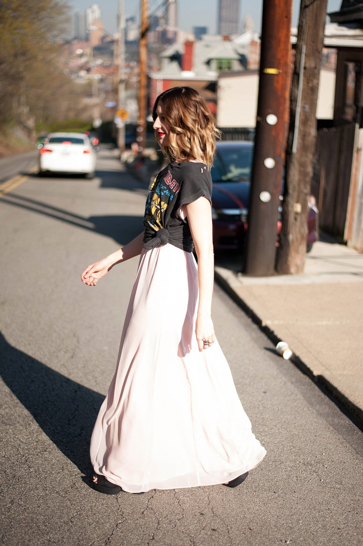 women wearing a band tee over a maxi dress